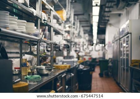Empty restaurant kitchen is blurred for background #675447514