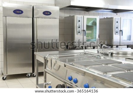 Empty restaurant kitchen with professional equipment