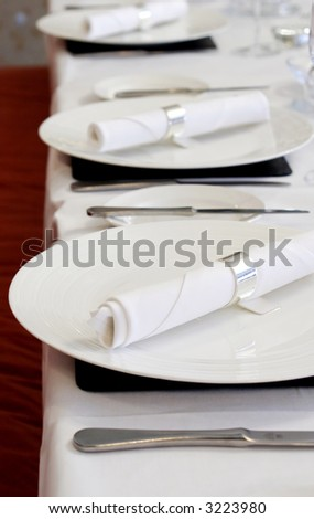 Empty restaurant with set tables