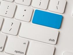 Empty return button on white modern keyboard.