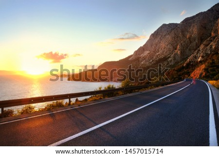 Empty road and sky nature landscape. Picturesque scene and sunrise above road