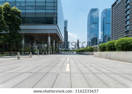Empty road and square with modern building exteriors  #1162233637