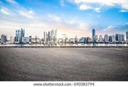 Empty road floor surface with modern city landmark buildings of chongqing bund Skyline of morning