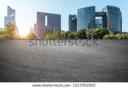 Empty road floor surface with modern city landmark buildings of hangzhou bund Skyline,zhejiang,china #1251902002
