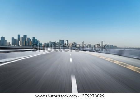 Empty road floor surface with modern city landmark buildings of hangzhou bund Skyline,zhejiang,china #1379973029
