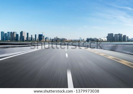 Empty road floor surface with modern city landmark buildings of hangzhou bund Skyline,zhejiang,china #1379973038