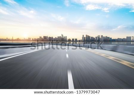 Empty road floor surface with modern city landmark buildings of hangzhou bund Skyline,zhejiang,china #1379973047