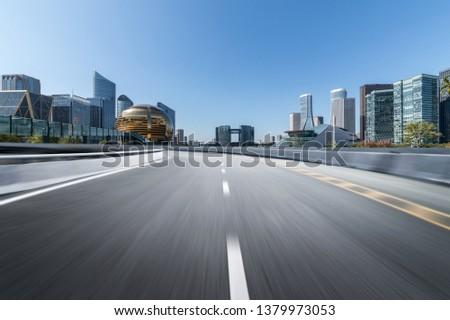 Empty road floor surface with modern city landmark buildings of hangzhou bund Skyline,zhejiang,china #1379973053