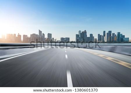 Empty road floor surface with modern city landmark buildings of hangzhou bund Skyline,zhejiang,china #1380601370