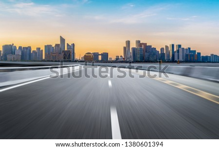 Empty road floor surface with modern city landmark buildings of hangzhou bund Skyline,zhejiang,china #1380601394