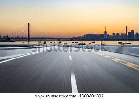 Empty road floor surface with modern city landmark buildings of hangzhou bund Skyline,zhejiang,china #1380601892