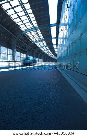 Empty road surface floor in tunnel inside #445018804