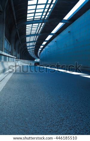 Empty road surface floor in tunnel inside #446185510