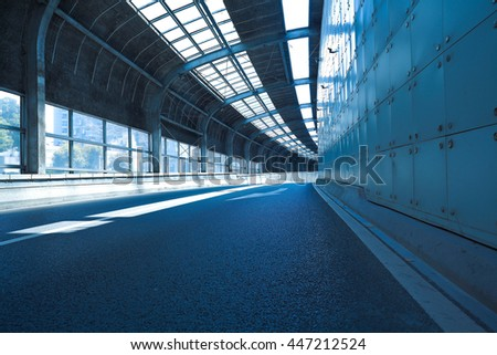 Empty road surface floor in tunnel inside #447212524