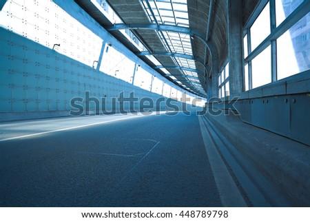 Empty road surface floor in tunnel inside #448789798