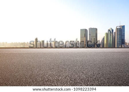 Empty road surface floor with modern city landmark buildings backgrounds in Shanghai bund Skyline  #1098223394