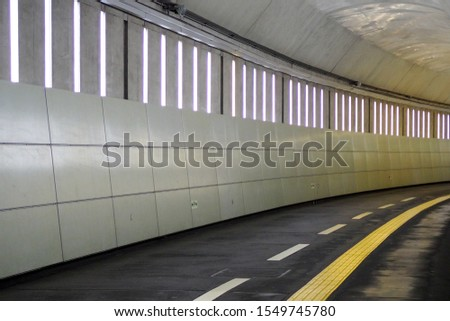 Empty road tunnel equip with tactile paving for impaired people #1549745780