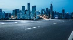 empty road with city skyline,beijing,china.