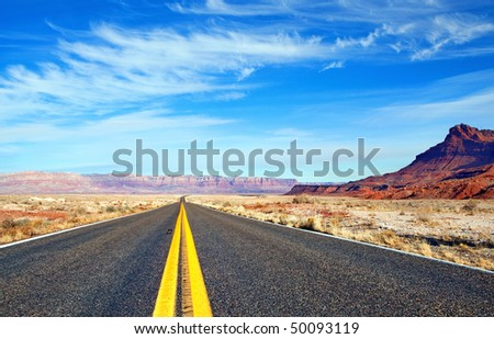 empty road with mountains...