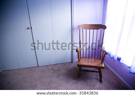 Empty rocking chair in room next to window stock photo for Chair next to window