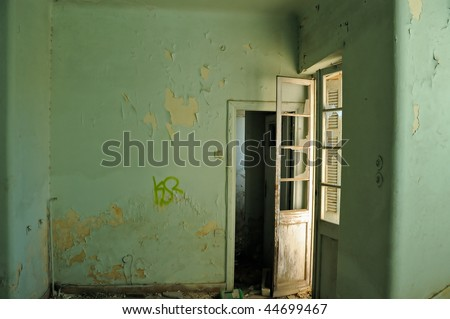 Empty room and textured peeling paint wall. Abandoned house interior.