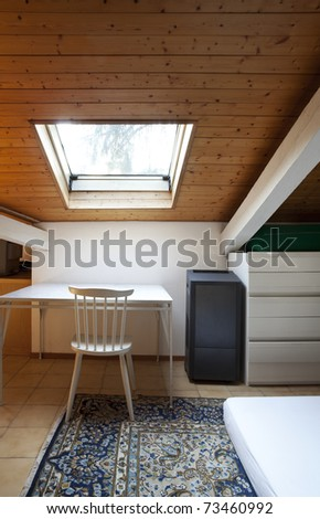 empty room in loft, skylight