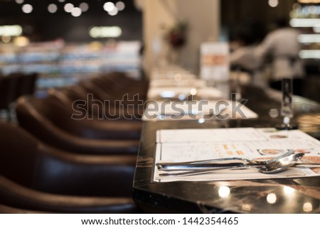 Empty room nobody Classic style of Restaurant with wooden table leather high chair with fork knife spot low light, interior design with calm and business discussion talk or private dinner couple