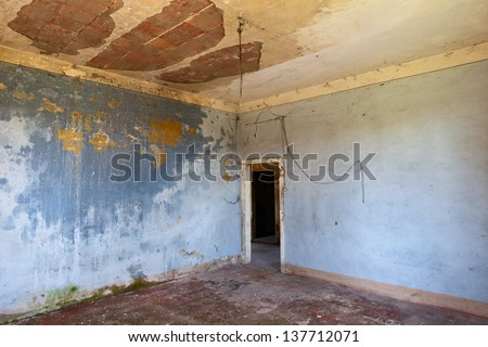 empty room of an abandoned house - old dirty hall in ruins