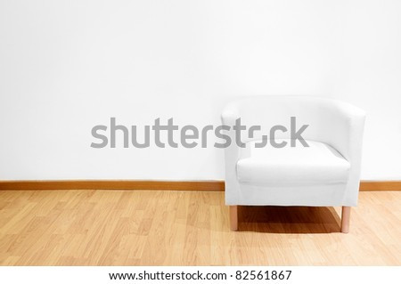 Empty room with a white sofa
