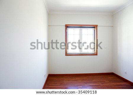 Empty room with a window and white walls in a new house