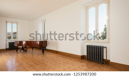 Empty room with antique piano and vintage heaters. Fantastic view. Nobody inside
