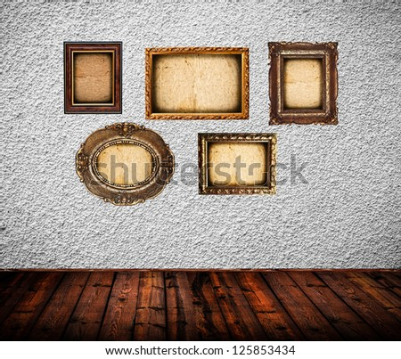 Empty room with blank vintage picture frames - stock photo