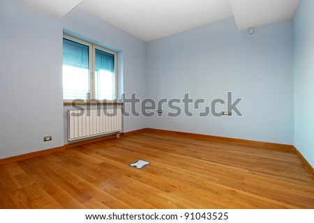 Empty room with blue walls in renovated home