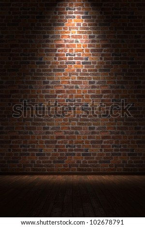 Empty room with brick wall and light from above