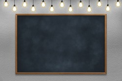 Empty room with chalkboard and white concrete wall with bulb lights lamp. nice brick show room with spotlights. Concept business, drawing, ideas, education, art.