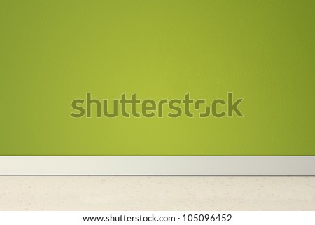 Empty room with green wall and linoleum