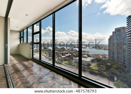 Empty room, with huge windows and a gorgeous view. stock photo