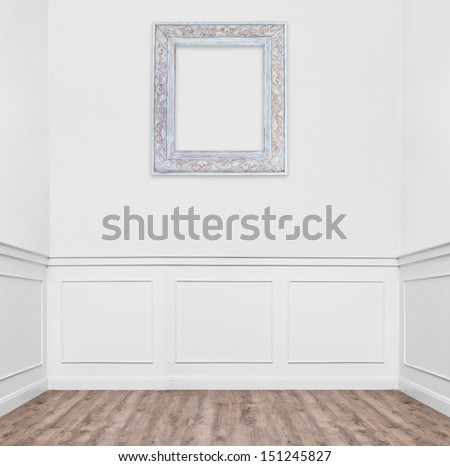 empty room with one frame hanging on the wall