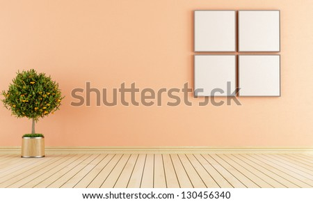 Empty room with plant and frame