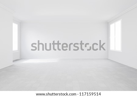 Empty room with two windows and radiator attached to wall