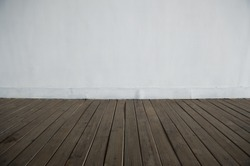 empty room  with white wall and wood floor background.