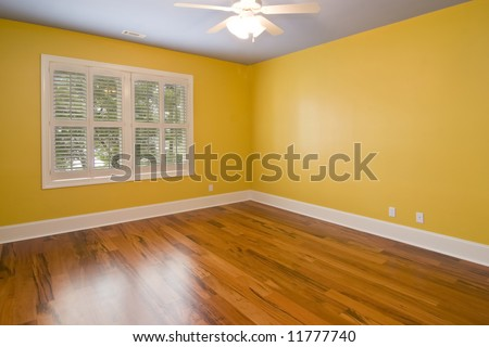 empty room with yellow walls and view windows #11777740