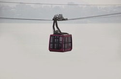 Empty Ropeway or cable car cruising over river Brahmaputra in Assam, India