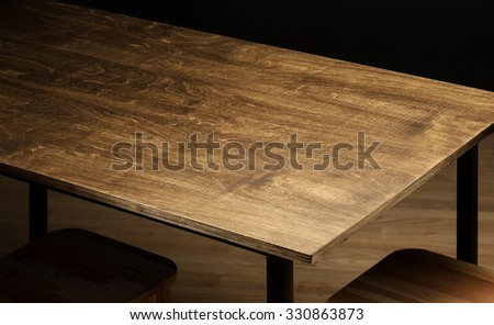 Empty rough wooden table top in the dark room #330863873