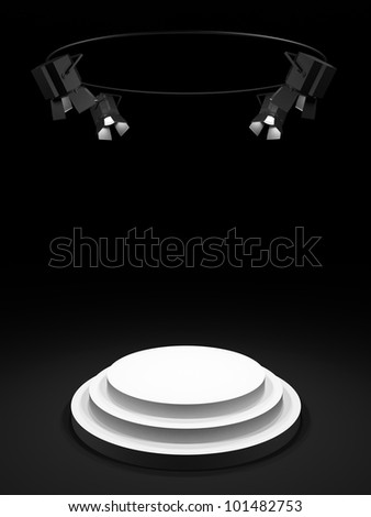 Empty round white stage in the dark room, shined with searchlights.