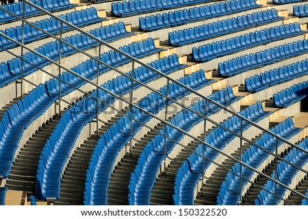Empty rows of chairs, seats in the concert hall, in the sports hall