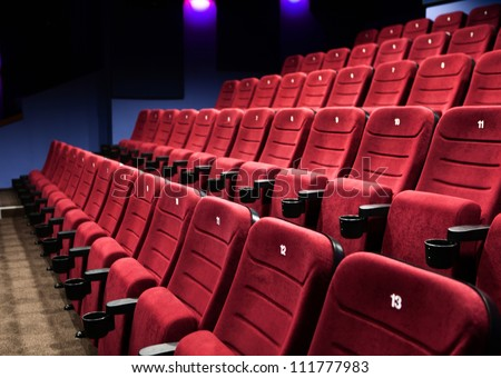Empty rows of  red cinema seats - stock photo