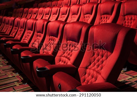 Empty  rows of red theater or movie seat sows of red cinema seats