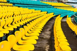 Empty rows of seats on a stadium before match