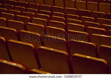 Empty rows of seats without people in cinema or concert hall view from back side #568803937